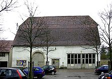 Zehntscheuer Schömberg, nördliche Traufseite, urspr. mit zwei rundbogigen Toren (Foto: R. Allgaier, Schömberg)  / Zehntscheuer in 72355 Schömberg