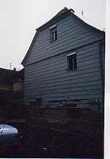 Gesamtansicht von Nordwesten / Wohn- und Geschäftshaus in 74189 Weinsberg